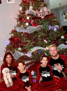 Eric graham and family in front of christmas tree