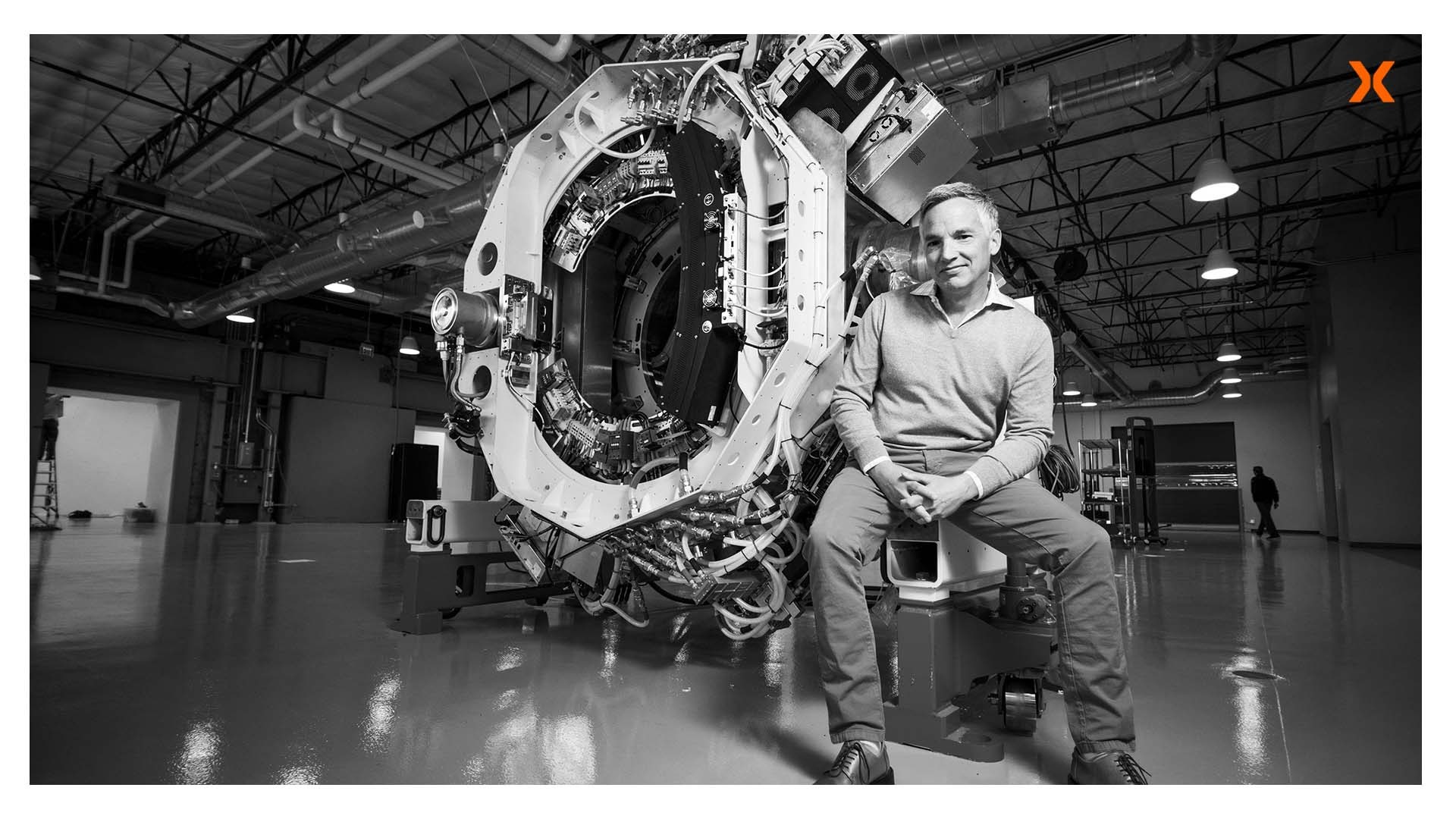 todd powell sitting in front of reflexion machine